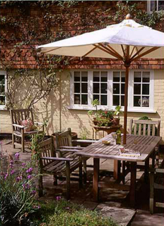 Table and chairs in the garden at the Dovecote bed and breakfast Chiddingfold